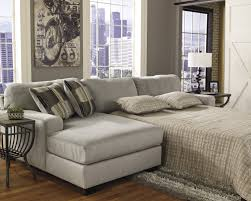 orange color of leather sofa with cushions low living table grey