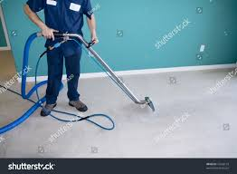 professional carpet steam cleaner vacuuming home stock photo