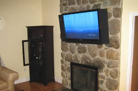 bristol ct u2013 tv above fireplace in new home home theater