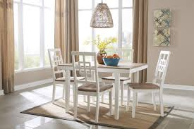 brovada dining table 4 chairs by ashley