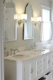 sinks with venetian mirrors and pretty sconces master bath