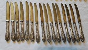 antique set of 16 knives and 17 forks in brass with silver handles