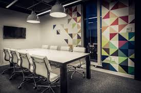 quidco office meeting room with custom steel frame table with