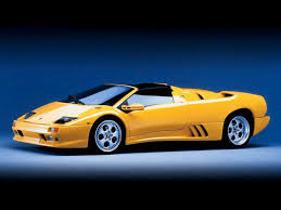 golden cars wallpaper awesome exsotic cars golden teorg with blue car download
