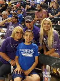desmond family presents check to help fight nf children s tumor