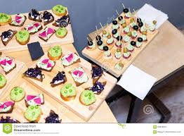wooden tray of appetizers on pallet coffee table at banquet with