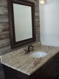 powder room with barn wood accent wall granite counter and vanity