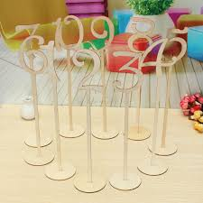 wooden table numbers stand on a sticks for wedding birthday