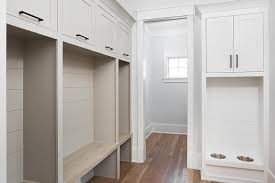 white mudroom cabinets with stained oak countertops cottage