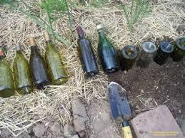 how to make a wine bottle garden border bottles pinterest