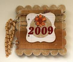 chipboard albums 2009 scalloped calendar clear scraps acrylic chipboard album