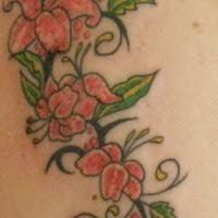 tribal lily flower on fire tattoo tattooimages biz