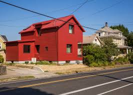 a small red victorian house in portland