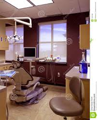 dental exam room empty patient chair and light royalty free