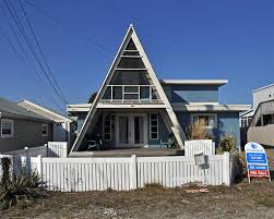 a frame style house beach block dewey beach by the sea by the