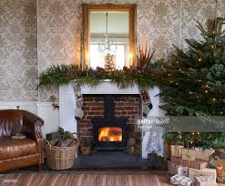christmas tree and fireplace in living room stock photo getty images