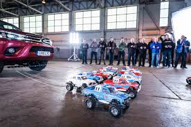 watch little remote controlled cars tow a toyota hilux pickup