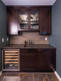 simple wet bar design with dark wood shaker style cabinetry dry
