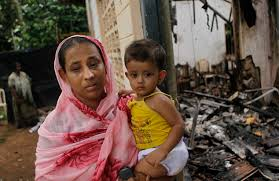 Sri Lankan Muslims killed in attack by Buddhists   Daily Mail Online Daily Mail A Sri Lankan Muslim woman carries her daughter while standing outside her burnt house in Adhikarigoda
