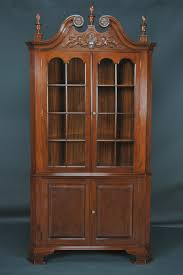 traditional brown lacquer mahogany wood tall corner storage