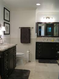 decor wooden vanity with granite countertop and wall decors for