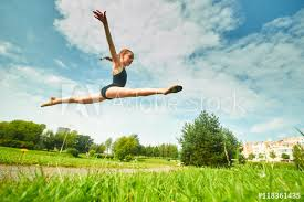 pretee models young beautiful preteen girl doing gymnastics outdoors buy this