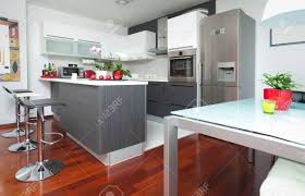 modern interior of open plan kitchen and living room stock photo