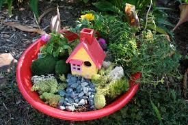 red painted fairy garden container with miniature home plus