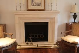 white stone fireplace mantel with brick stone fireplace and brown