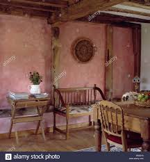 terracotta paint effect sponged walls in cottage dining room with