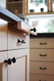 black pulls for white kitchen cabinets 5 black and white kitchen remodel trends hammer