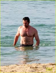 hugh jackman goes for a christmas eve swim in sydney photo