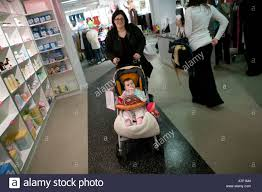 maternity stores nyc woman shoping with baby for clothes at the destination maternity