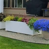 extra large custom white pvc planters in front of customers home