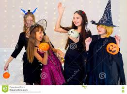 group of teenagers wearing halloween costumes fear of ghost stock