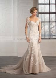 ivory lace wedding dress mermaid neckline sleeves keyhole back sweep