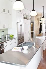 white kitchen island with stainless steel top palmerston design galley kitchen with modern white