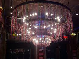 mardi gras bead chandelier mardi gras bead chandelier in foyer at razzoo s picture of