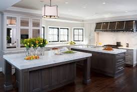 kitchen with 2 islands dc metro white marble countertops kitchen traditional with drum