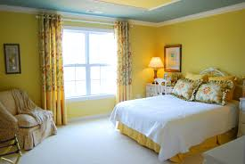 yellow wall room color plus glass windows and long yellow curtains