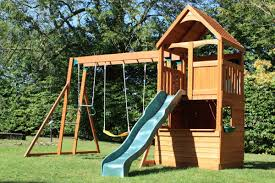 melford climbing frame with slide swings and rock wall ladder