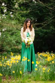 an emerald green vintage dior gown and gold jacket for an