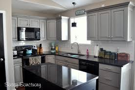 glass countertops kitchens with black backsplash diagonal tile
