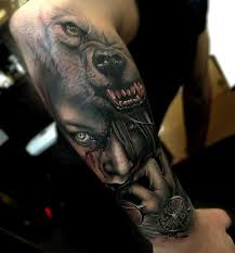 angry wolf on right arm