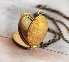 necklace with locket images Gold locket necklace jewelry four photo folding locket necklace jpg