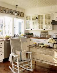 beige vintage kitchen with rustic wood island and l shaped cabinet