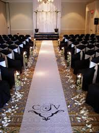 black aisle runner aisle markers aisle runner altar arch arrangements indoor ceremony
