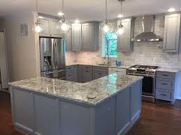 blue kitchen cabinets with granite countertops bright blue grey kitchen created with baltic bay thomasville
