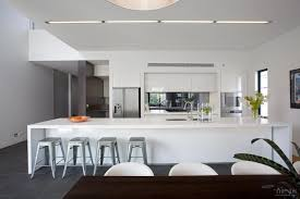 sleek white kitchen design in new house with 5m long island