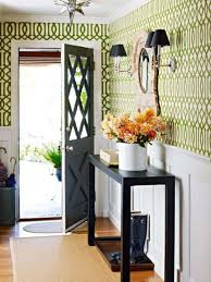 small front hall design with wallpaper and console table and